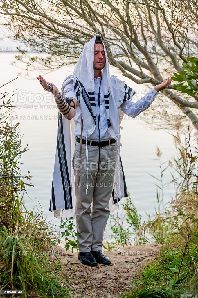 Ultra Orthodox Jewish man prays in the forest stock photo