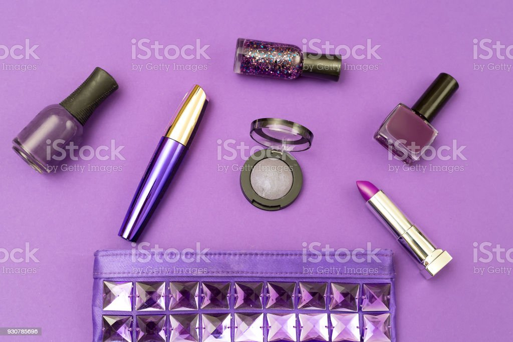Ultra Violet cosmetics on an ultra violet background. Top view stock photo