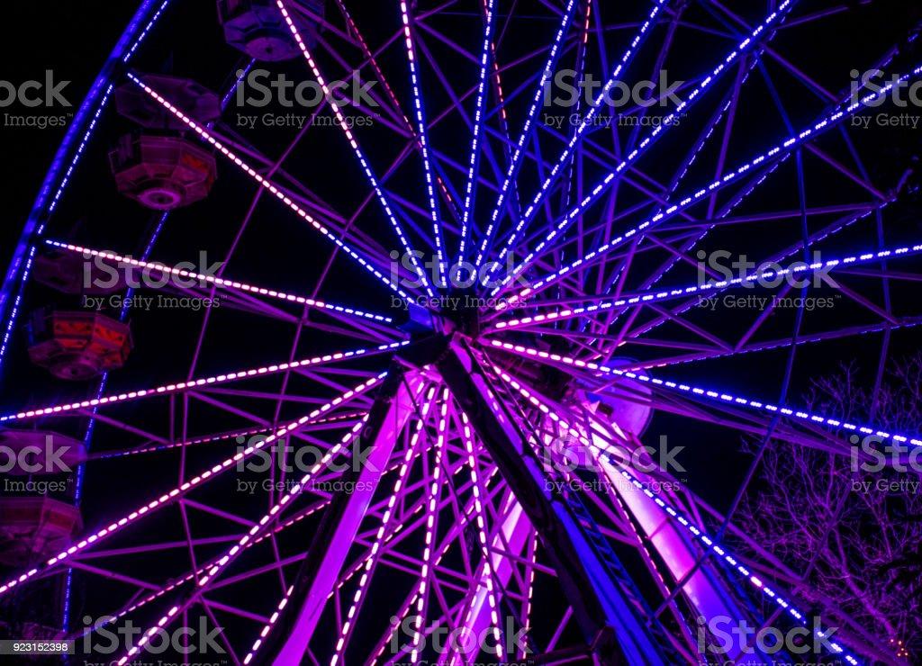 Ultra violet Ferris wheel stock photo