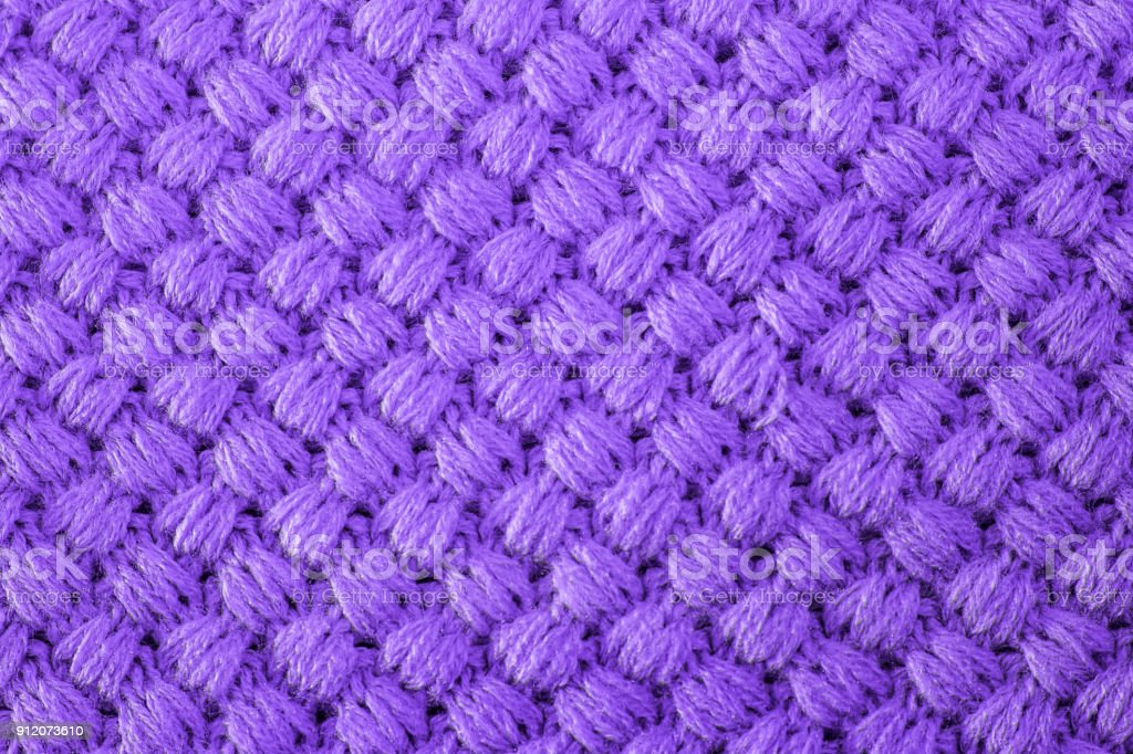 Ultra violet knitted fabric made of heathered yarn textured background. Colour trends on design wallpapers. stock photo