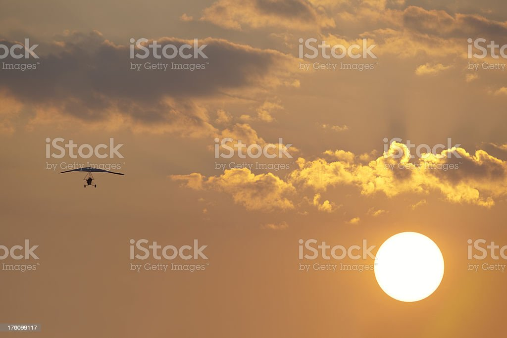 Ultralight Airplane Flying Above the Summer Sun royalty-free stock photo