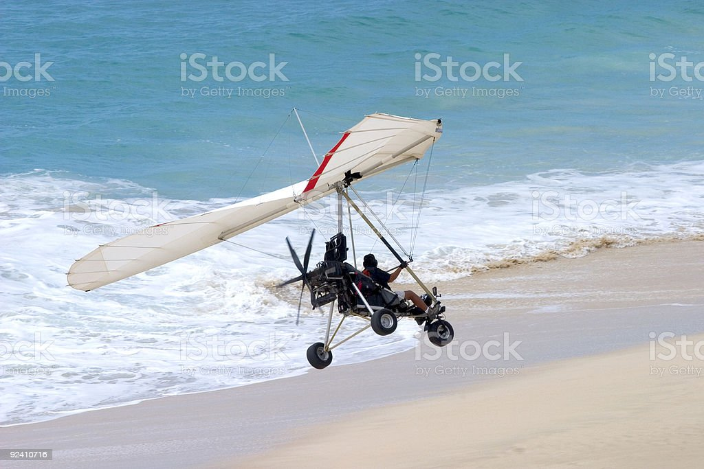 Ultralight Flying coming in for a landing on the beach  Air Vehicle Stock Photo