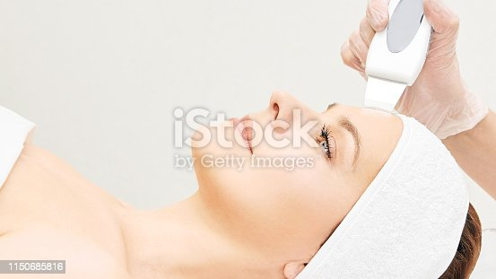 istock Ultrasinic cosmetology face equipment. Facial skin cleaning. Beauty female girl. Medical salon care machine 1150685816