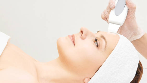 Ultrasinic cosmetology face equipment. Facial skin cleaning. Beauty female girl. Medical salon care machine Ultrasinic cosmetology face equipment. Facial skin cleaning. Beauty female girl. Medical salon care machine. tighten stock pictures, royalty-free photos & images