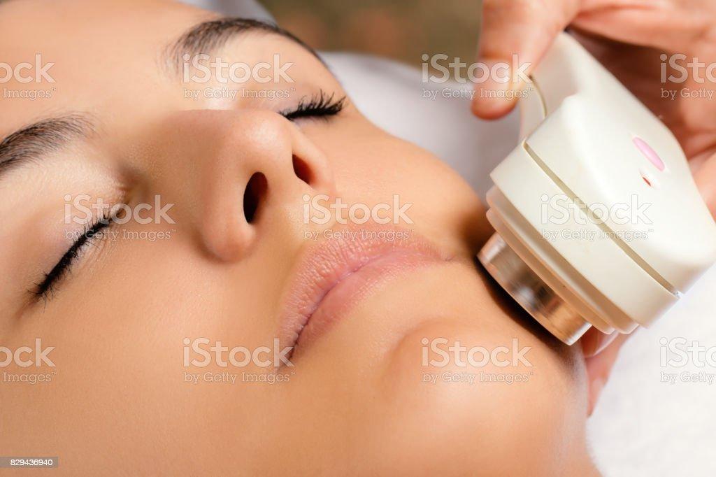 Ultrasonic facial treatment on woman. stock photo