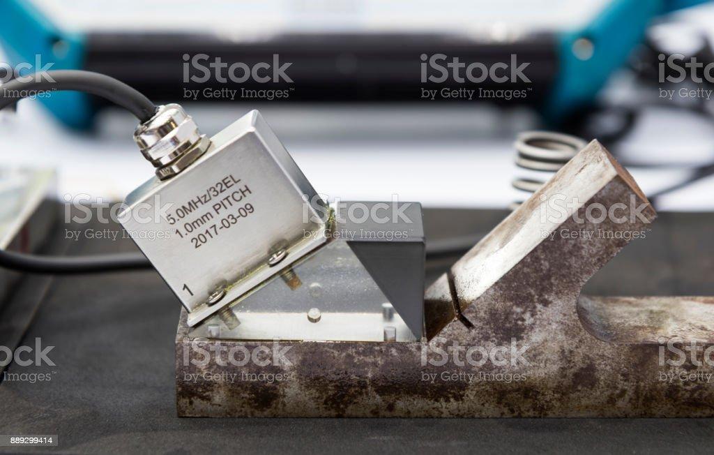 ultrasonic probe testing welding stee stock photo