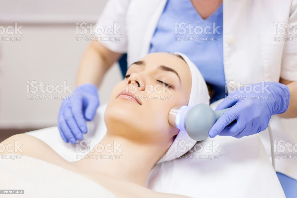 Ultrasound cavitation, face skin anti age treatment stock photo