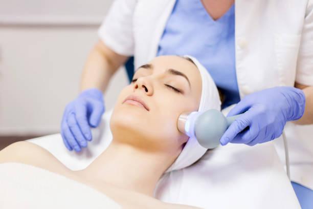 Ultrasound cavitation, face skin anti age treatment stock photo