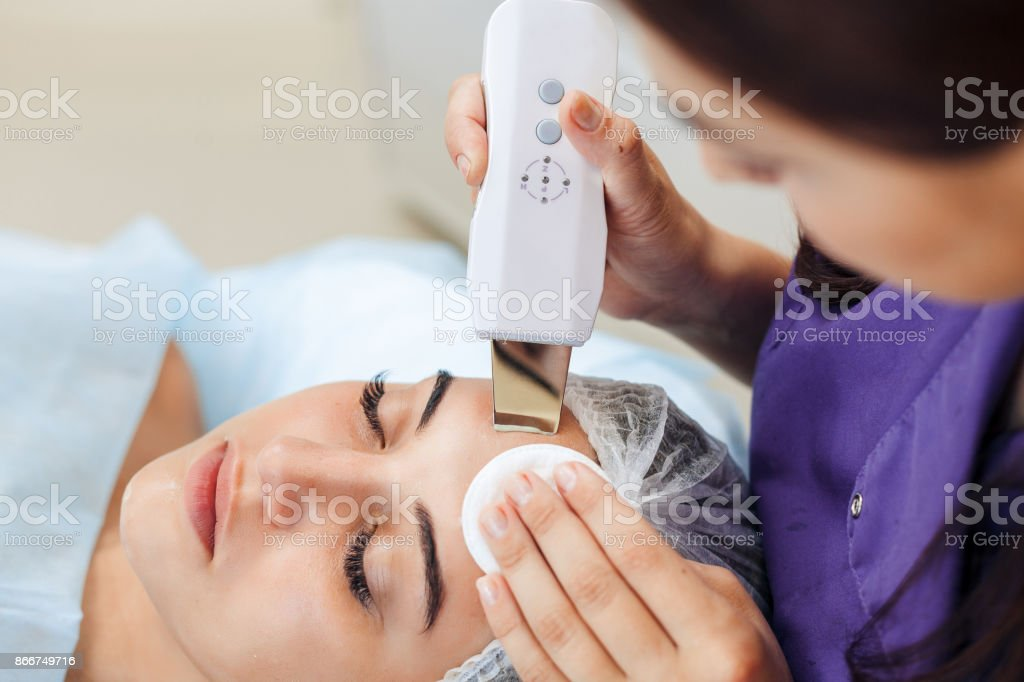 Ultrasound cavitation, face skin cleansing stock photo