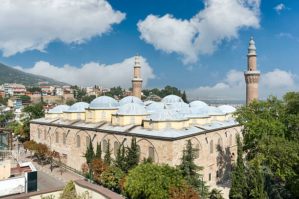 Ulu Cami (Grand Mosque of Bursa), Turkey Bursa, Turkey - August 17,2015: Ulu Cami is a mosque in Bursa, Turkey. Built in the Seljuk style, it was ordered by the Ottoman Sultan Bayezid I and built between 1396 and 1399. The mosque has 20 domes and 2 minarets. grand mosque stock pictures, royalty-free photos & images