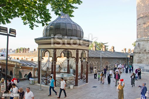 Bursa, Turkey - May 14, 2017: People in the courtyard of Grand Mosque- Ulu Cami for worshippers gather. The mosque is most important mosque in Bursa and a landmark of early Ottoman architecture built in 1399.
