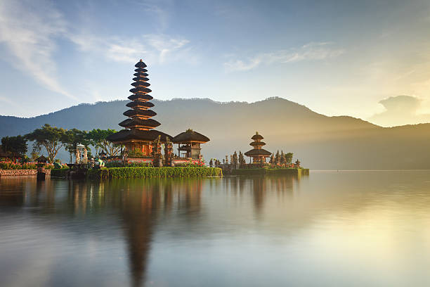 Ulun Danu temple at sunrise, Bali Pura Ulun Danu hindu temple on lake Beratan, Bali, Indonesia indonesia stock pictures, royalty-free photos & images