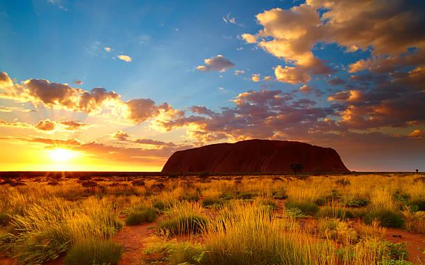 uluru at dawn - natural landmark stock pictures, royalty-free photos & images