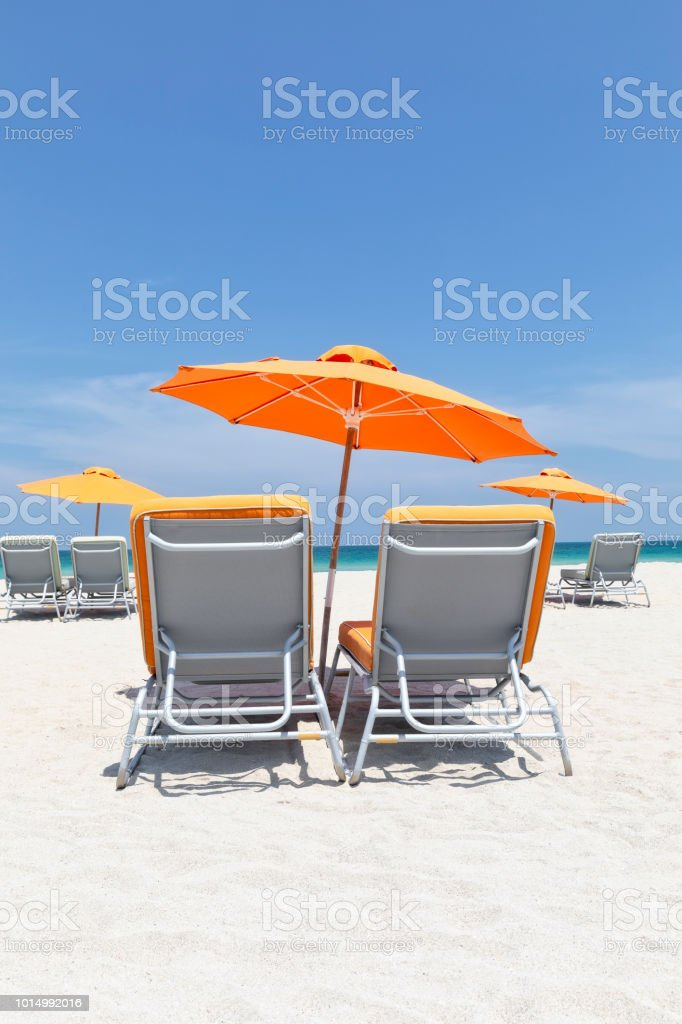 Umbrella and Chairs on Miami Beach stock photo