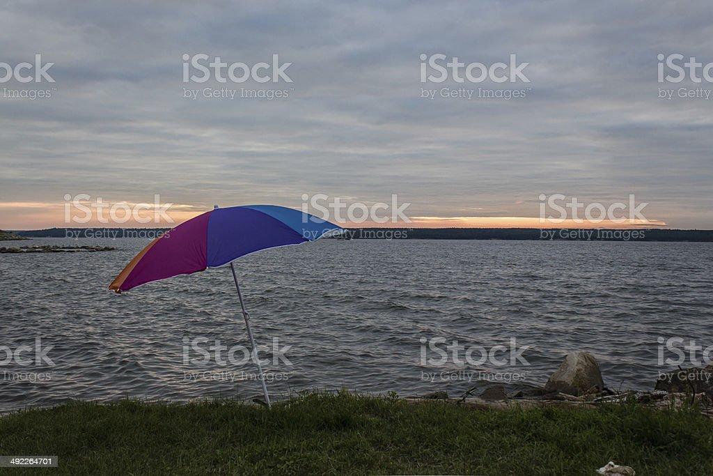 umbrella beside the lake royalty-free stock photo