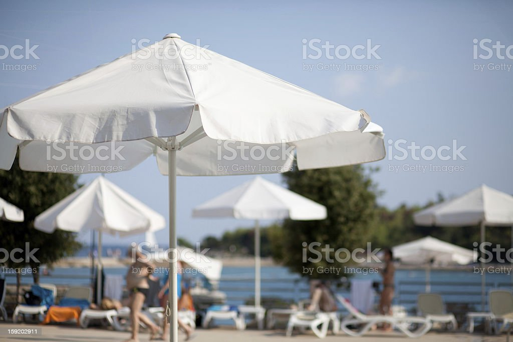 umbrella by the swimming pool royalty-free stock photo