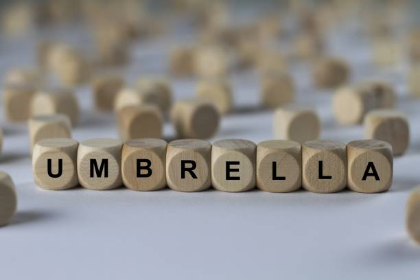 umbrella - cube with letters, sign with wooden cubes series of images: cube with letters, sign with wooden cubes aegis stock pictures, royalty-free photos & images