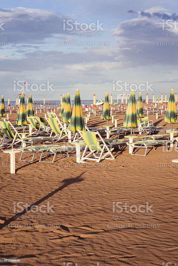 Umbrella in Rimini beach at sunset royalty-free stock photo