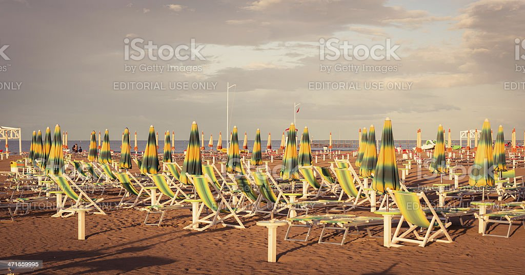Umbrella in Rimini beach at sunset royalty-free stock photo