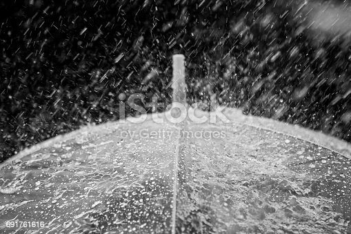 691761646istockphoto Umbrella in the rain 691761616