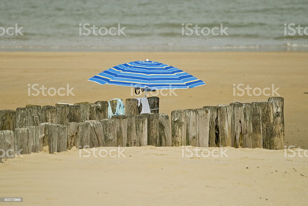 Umbrella on a beach royalty-free stock photo