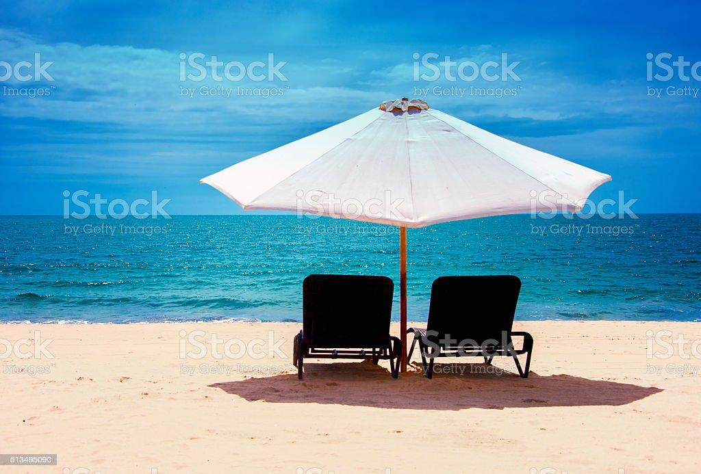 Umbrella on the beach stock photo