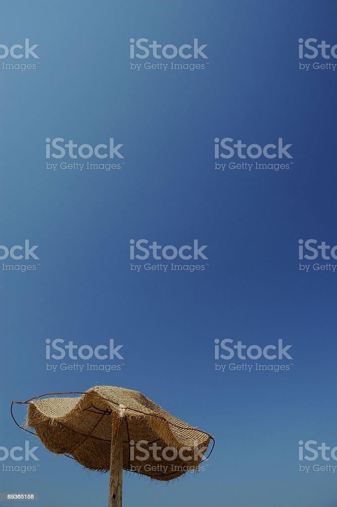 Umbrella on the beach royalty-free stock photo