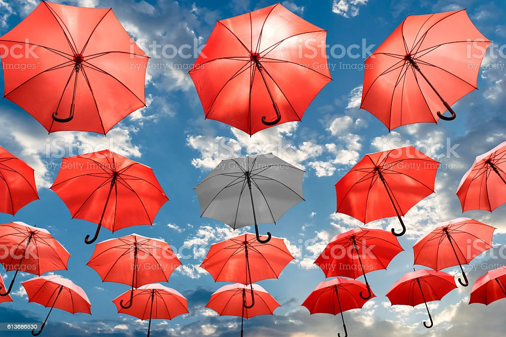 umbrella standing out from the crowd unique concept mental health stock photo