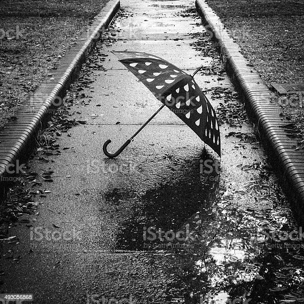 Umbrella That Has Been Placed In Solitary Stock Photo - Download Image Now