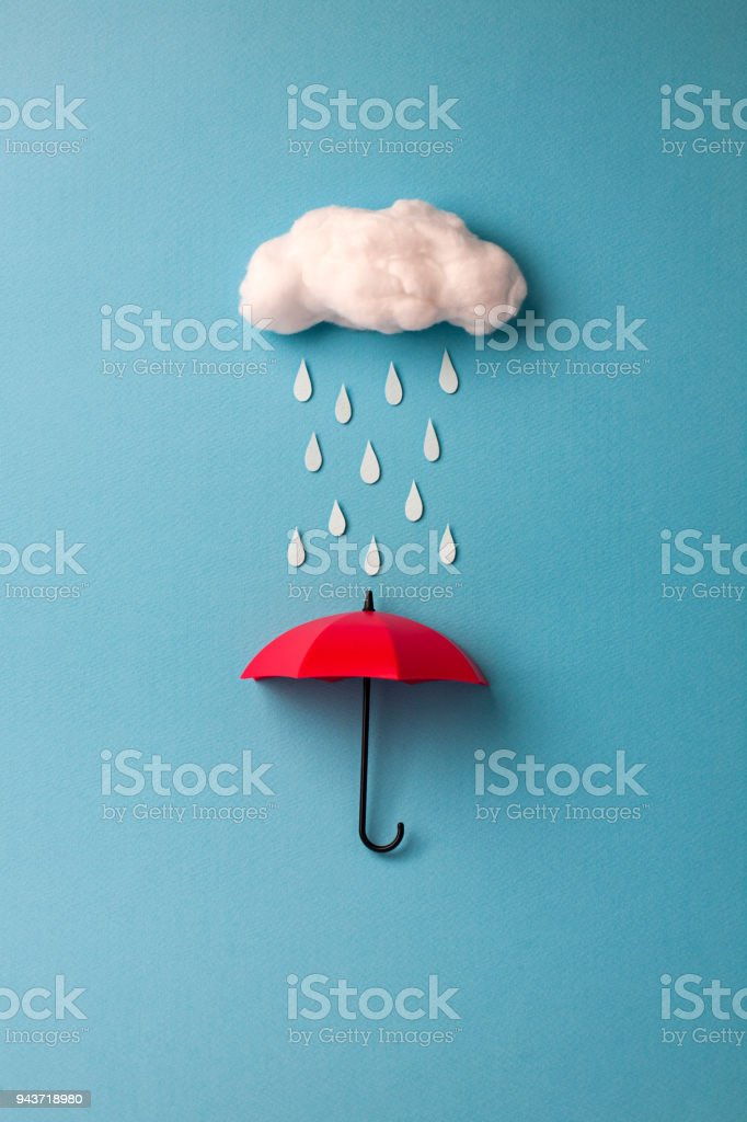 umbrella under the cloud on sky blue background stock photo
