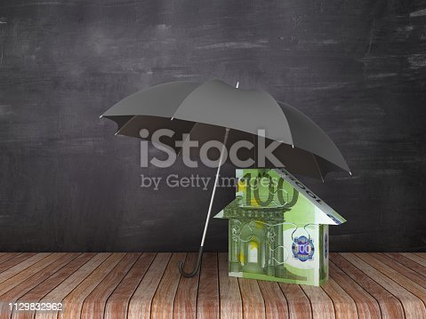 Umbrella with Euro Bill Puzzle House on Wood Floor - Chalkboard Background - 3D Rendering