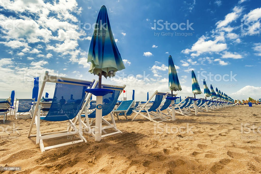 Umbrellas and chairs in Versilia, Italy stock photo
