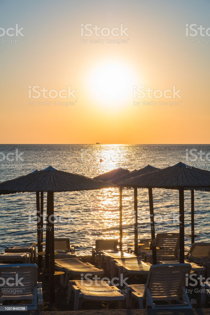 Umbrellas and sunbeds at the beach stock photo