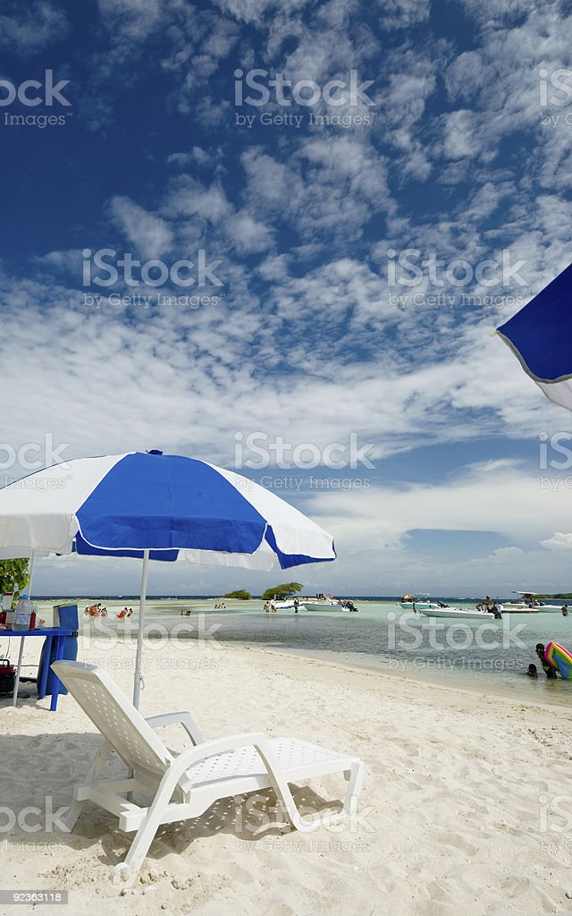 Umbrellas at a Tropical island  white sand beach royalty-free stock photo