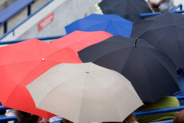 Umbrellas at the game stock photo