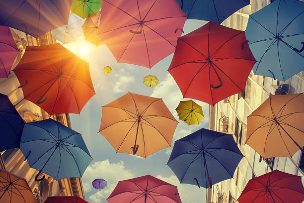 umbrellas falling from the sky - umbrellas stock photos and pictures