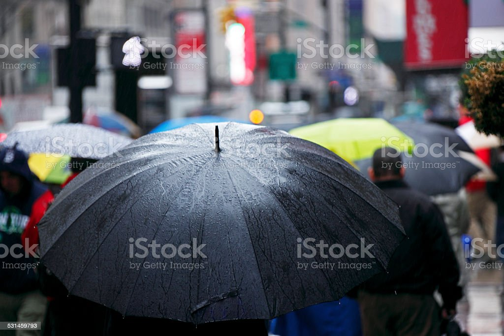 Umbrellas in wet, wintry New York City stock photo