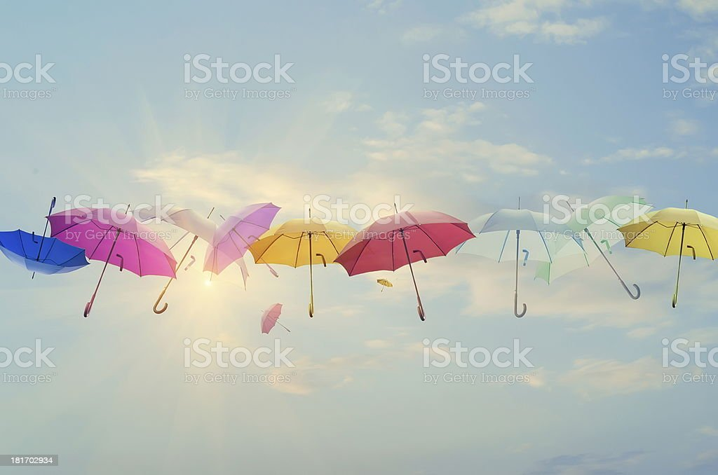 Umbrellas line-up across the sky stock photo