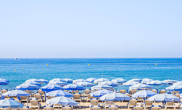 Umbrellas on a beach in Cannes, South of France – Foto