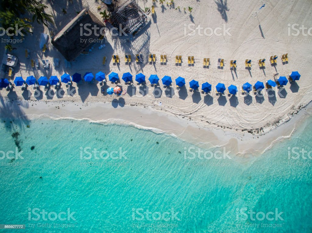 Umbrellas on the beach of Isla Mujeres - Aerial view stock photo