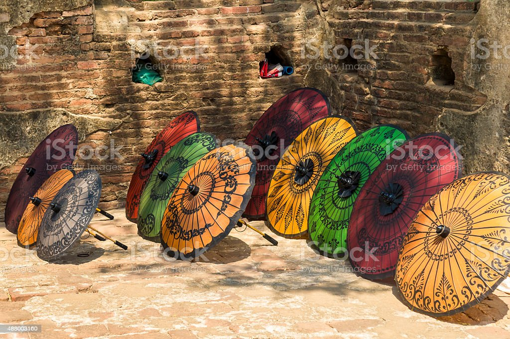 Umbrellas selling at a pagoda in Myanmar stock photo