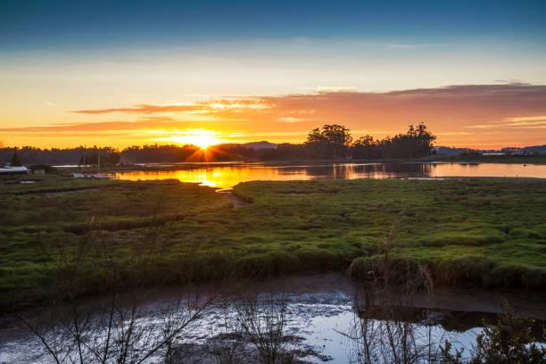 Umia river marsh at sunset stock photo