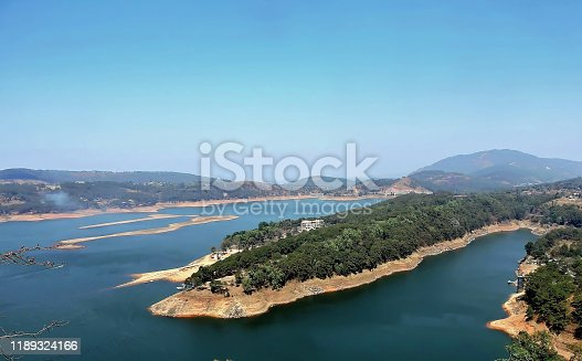 istock Umium lake is a reservoir in the hills 15 km (9.3 mi) north of Shillong, India. The lake is a major tourist attraction for the state of Meghalaya. It is also a popular destination for water sports. 1189324166