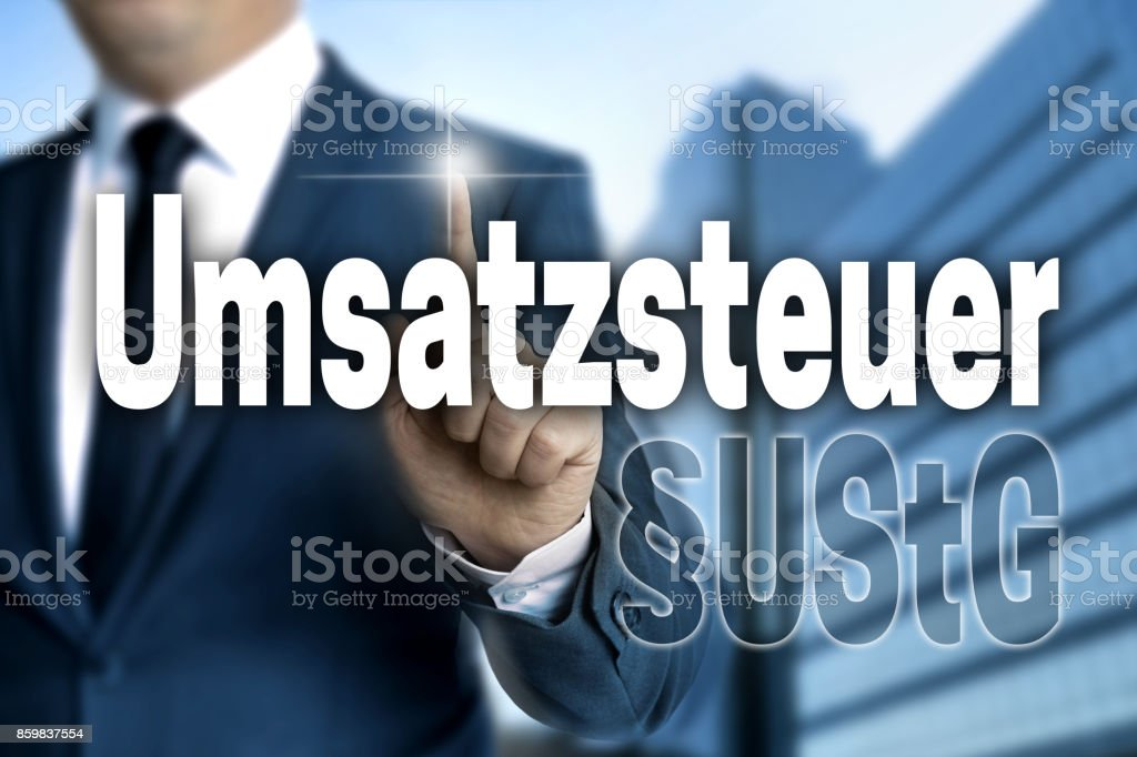 Umsatzsteuer (in german Sales tax) touchscreen is operated by businessman stock photo