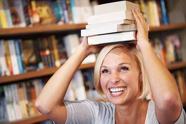 Unable to resist buying some books.... stock photo