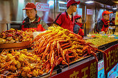 Beijing/China - 25 February 2017: Unacquainted chinese Chef Cooking and Selling local cuisine on wangfujing Walking street in beijing city,China travel