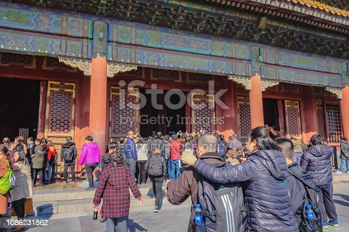 Beijing/China - 25 February 2017: Unacquainted chinese people or touristin come to visit Forbidden Palace in Holiday at beijing Capital City of china.