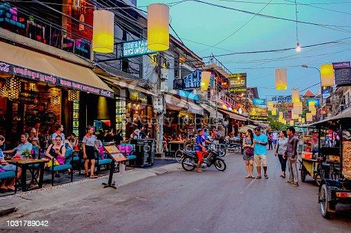 unacquainted  People walking in Pub street in Siem reap cambodia