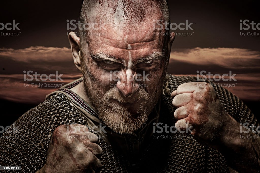 Unarmed bloody viking warrior in emotional pose stock photo