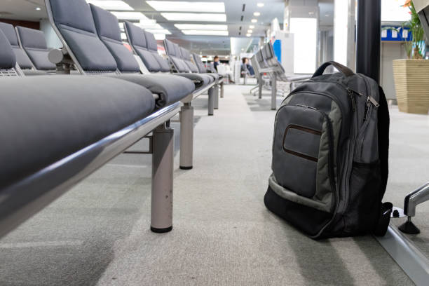 Unattended cabin backpack abandoned on the floor at airport. stock photo